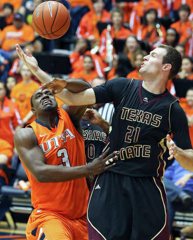 Roadrunner center Larry Wilkins battles Matt Staff under the hoop as UTSA hosts Texas State in mens' basketball at the UTSA Convocation Center on January 19, 2013. Photo: Tom Reel, Express-News / ©2012 San Antono Express-News