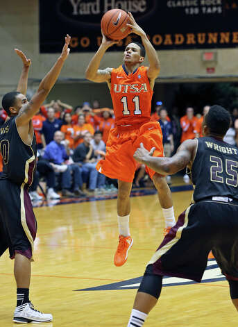 Michael Hale III shoots a three pointer as UTSA hosts Texas State in mens' basketball at the UTSA Convocation Center on January 19, 2013. Photo: Tom Reel, Express-News / ©2012 San Antono Express-News