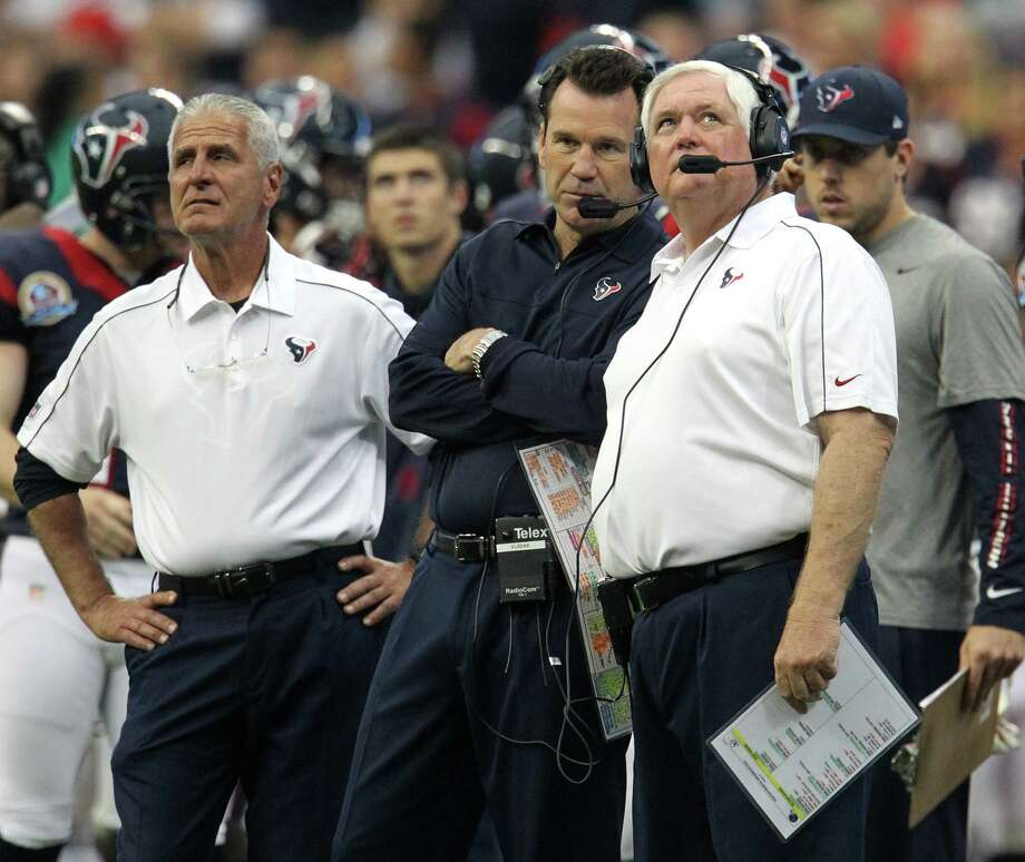Head coach Gary Kubiak, center, special teams coordinator Joe Marciano, left, and defensive coordinator Wade Phillips are all but locks to be back with the Texans. Photo: Karen Warren, Staff / © 2012 Houston Chronicle