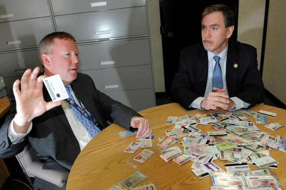 Director Owen McShane, left, and Executive Deputy Commissioner J. David Sampson talks about changes to state drivers licenses on Wednesday, Jan. 9, 2013, at New York State Department of Motor Vehicles in Albany, N.Y. (Cindy Schultz / Times Union) Photo: Cindy Schultz / 00020657A