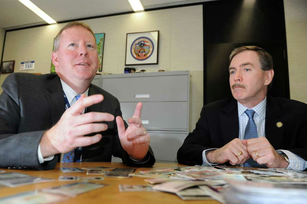 Director Owen McShane, left, and Executive Deputy Commissioner J. David Sampson talks about changes to state drivers licenses on Wednesday, Jan. 9, 2013, at New York State Department of Motor Vehicles in Albany, N.Y. (Cindy Schultz / Times Union)