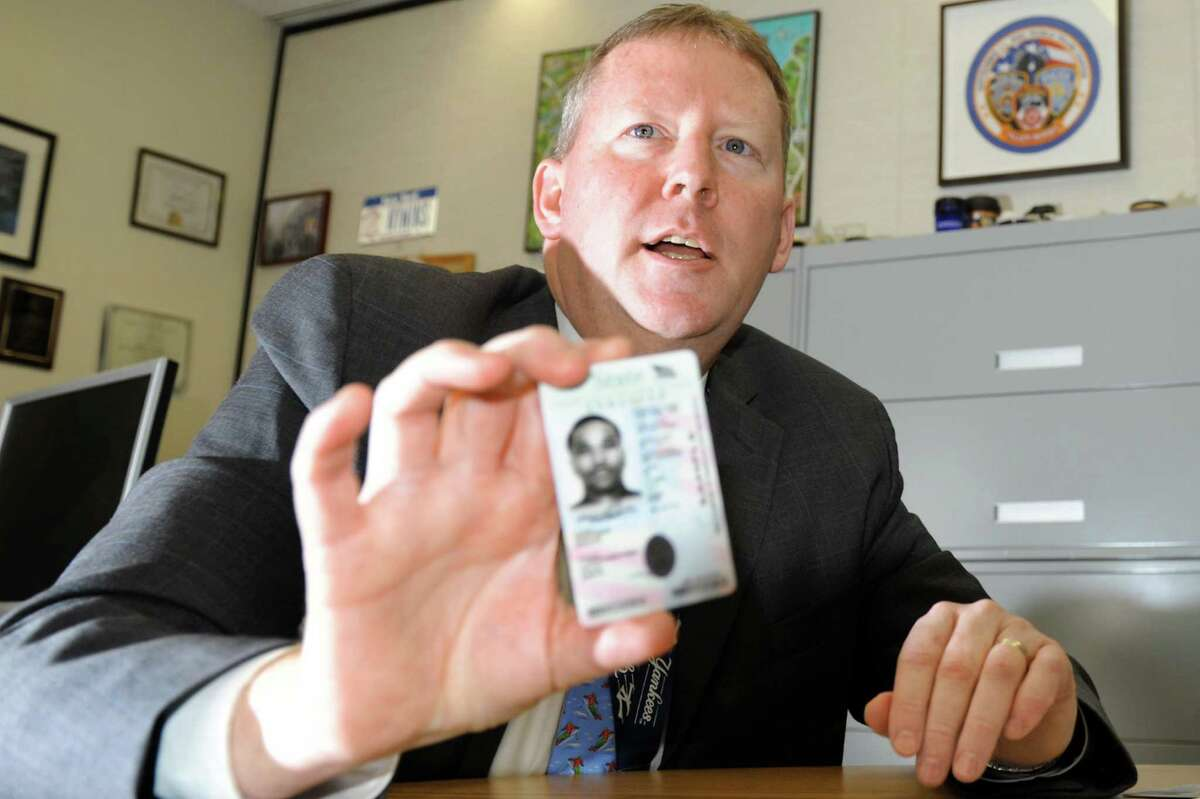 Director Owen McShane holds up a sample of a verticle state drivers license for persons under 21 years of age on Wednesday, Jan. 9, 2013, at New York State Department of Motor Vehicles in Albany, N.Y. (Cindy Schultz / Times Union)