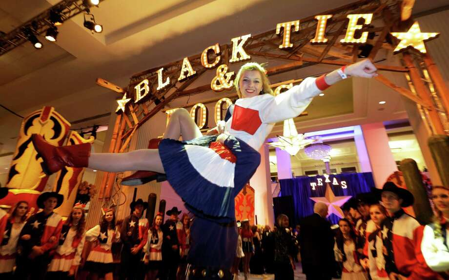 The Lake Highland Rangers from Dallas Tx., perform at the entrance of the Black Tie and Boots ball as part of the Inaugural festivities Saturday, Jan. 19, 2013 in National Harbor, Md.   (AP Photo/Steve Helber) Photo: Steve Helber, Associated Press / AP