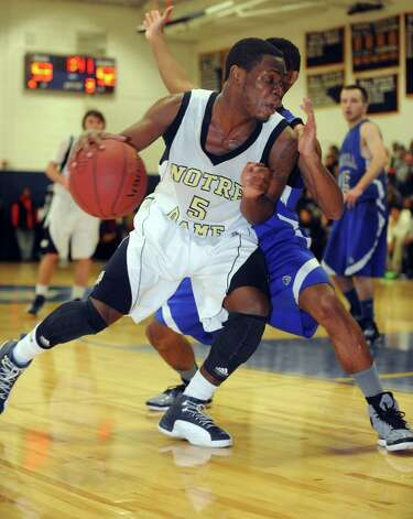 Notre Dame-Fairfield's Earl Coleman dribbles to the basket during game action against Bunnell High School Saturday, Jan. 19, 2013  in Fairfield, Conn. Photo: Autumn Driscoll / Connecticut Post