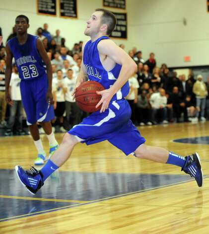 Bunnell's Tim White dribbles to the basket during game action against Notre Dame-Fairfield High School Saturday, Jan. 19, 2013  in Fairfield, Conn. Photo: Autumn Driscoll / Connecticut Post