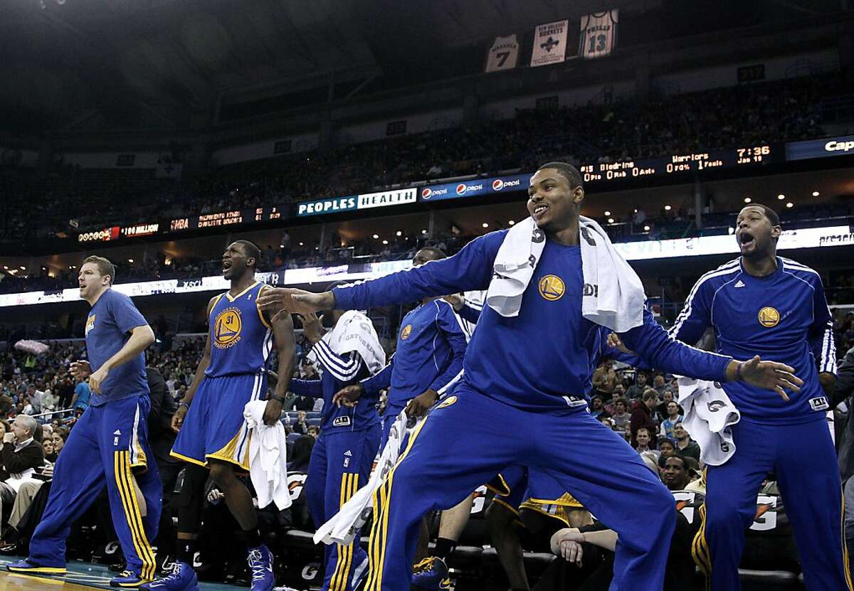 Golden State Warriors celebrate during the first half of an NBA basketball game against the New Orleans Hornets in New Orleans, Saturday, Jan. 19, 2013. The Warriors won 116-112. (AP Photo/Jonathan Bachman)