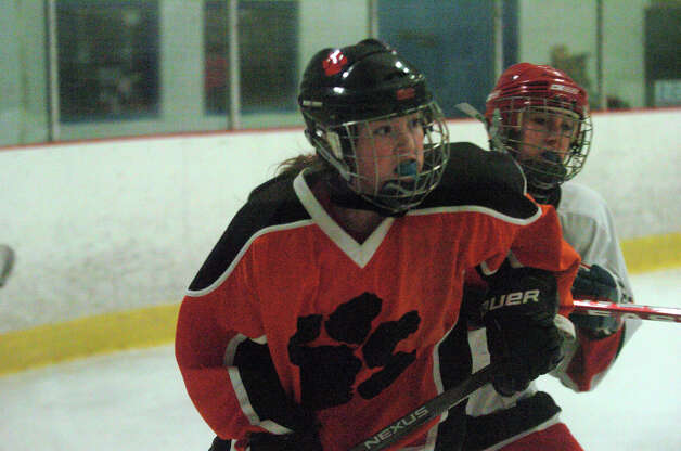 Ridgefield's Kate Lombardozzi moves along the boards as New Canaan hosts Ridgefield High School in a girls hockey game at the Darien Ice Rink in Darien, Conn., Jan. 19, 2013. Photo: Keelin Daly / Stamford Advocate Riverbend Stamford, CT