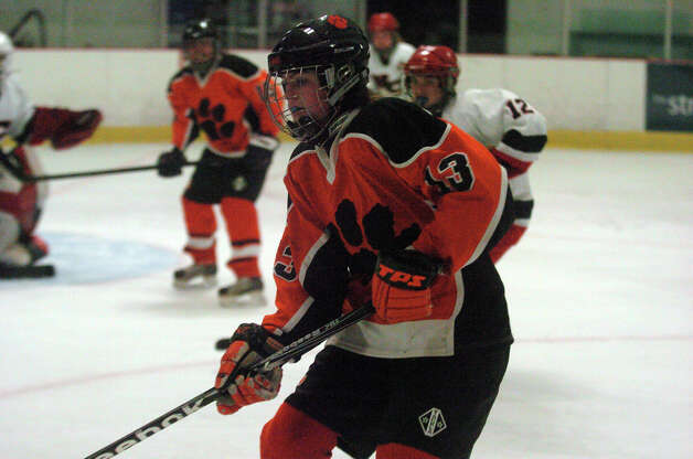 Ridgefield's Ellie Garelick moves along the boards as New Canaan hosts Ridgefield High School in a girls hockey game at the Darien Ice Rink in Darien, Conn., Jan. 19, 2013. Photo: Keelin Daly / Stamford Advocate Riverbend Stamford, CT