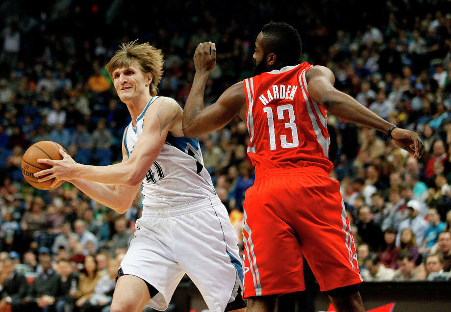 Andrei Kirilenko of the Timberwolves, passes around Rockets guard James Harden. Photo: Stacy Bengs, Associated Press / FR170489 AP