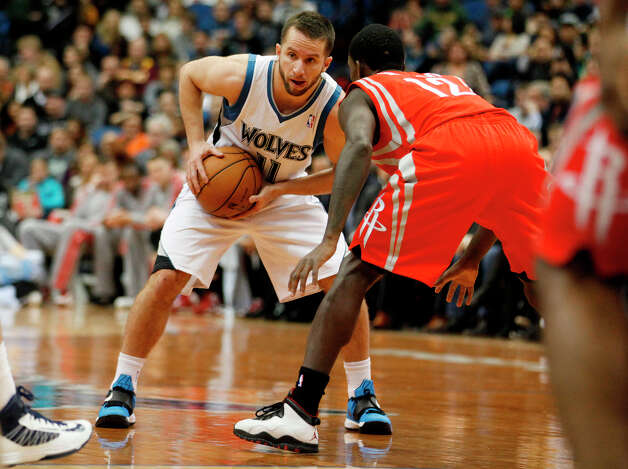 Timberwolves guard J.J. Barea looks to make a play against Patrick Beverley of the Rockets. Photo: Stacy Bengs, Associated Press / FR170489 AP