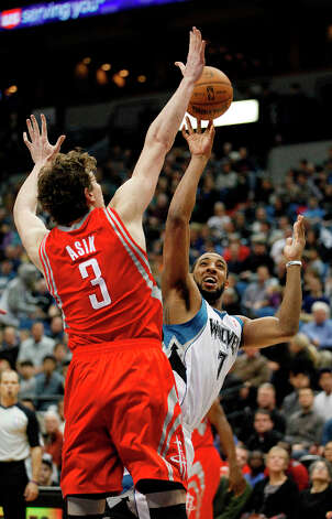 Timberwolves forward Derrick Williams shoots against Omer Asik of the Rockets. Photo: Stacy Bengs, Associated Press / FR170489 AP