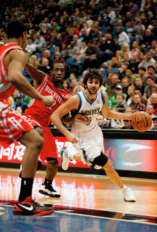 Jan. 19: Timberwolves 92, Rockets 79Timberwovles point guard Ricky Rubio drives the ball past Patrick Beverley of the Rockets. Photo: Stacy Bengs, Associated Press / FR170489 AP