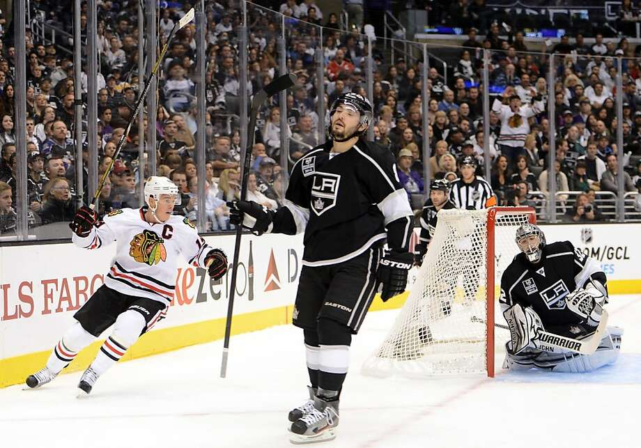 Jonathan Toews of the Blackhawks salutes Marian Hossa's goal. L.A.'s Drew Doughty doesn't. Photo: Harry How, Getty Images