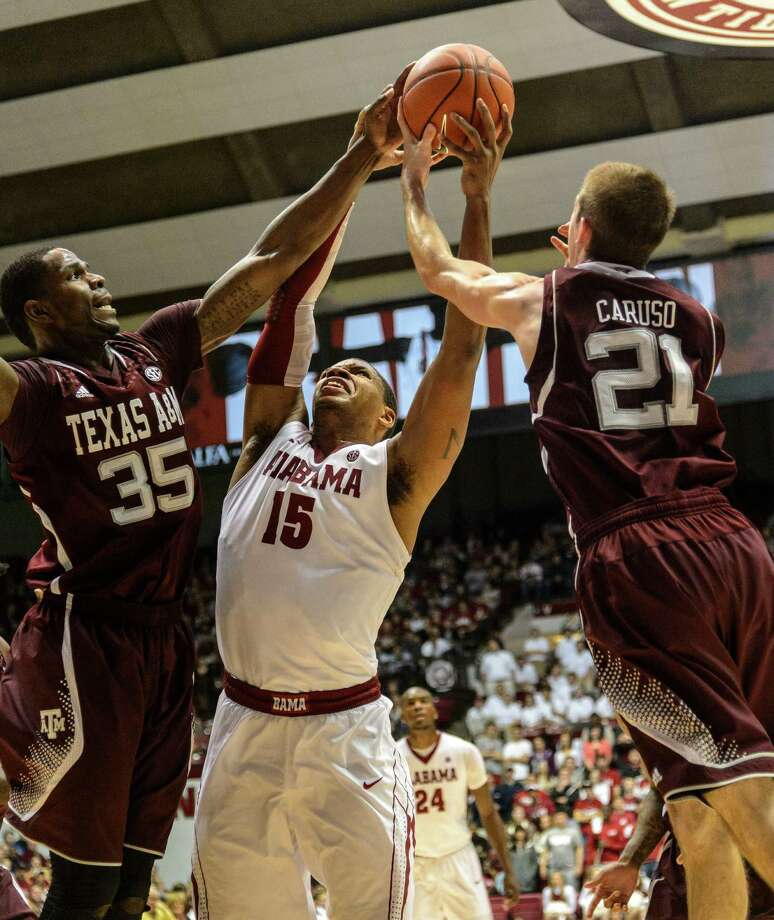 Alabama forward Nick Jacobs (15) works against Texas A&M forward Ray Turner (35) and guard Alex Caruso (21) for a rebound during an NCAA college basketball game Saturday, Jan. 19, 2013, in Tuscalooa, Ala. (AP Photo/AL.com, Vasha Hunt) MAGS OUT Photo: Vasha Hunt, Associated Press / AL.com
