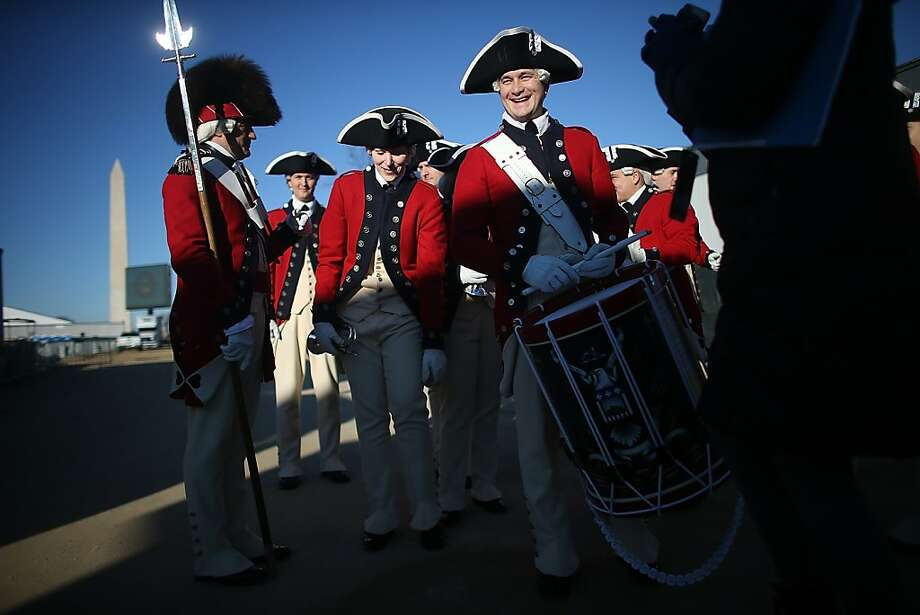 Members of the U.S. Army Old Guard Fife and Drum Corps gather after performing on the National Mall as Washington prepares for President Barack Obama's second inauguration on January 19, 2013 in Washington, DC. The U.S. capital is preparing for the second inauguration of U.S. President Barack Obama, which will take place on January 21. Photo: Mario Tama, Getty Images