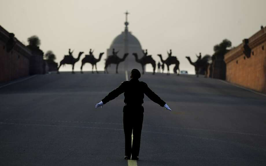 An Indian army conductor leads a military band during rehearsals for the upcoming Beating Retreat ceremony near the Presidential Palace in New Delhi, India, Saturday, Jan. 19, 2013. The ceremony is held annually on Jan. 29. Photo: Altaf Qadri, Associated Press