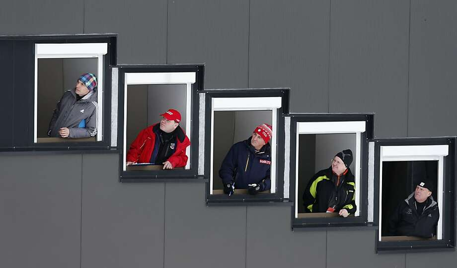 World cup judges look out of their tower during the competition jump at the Nordic Combined World Cup competition in Seefeld, Austria, on Saturday, Jan. 19, 2013. Photo: Matthias Schrader, Associated Press