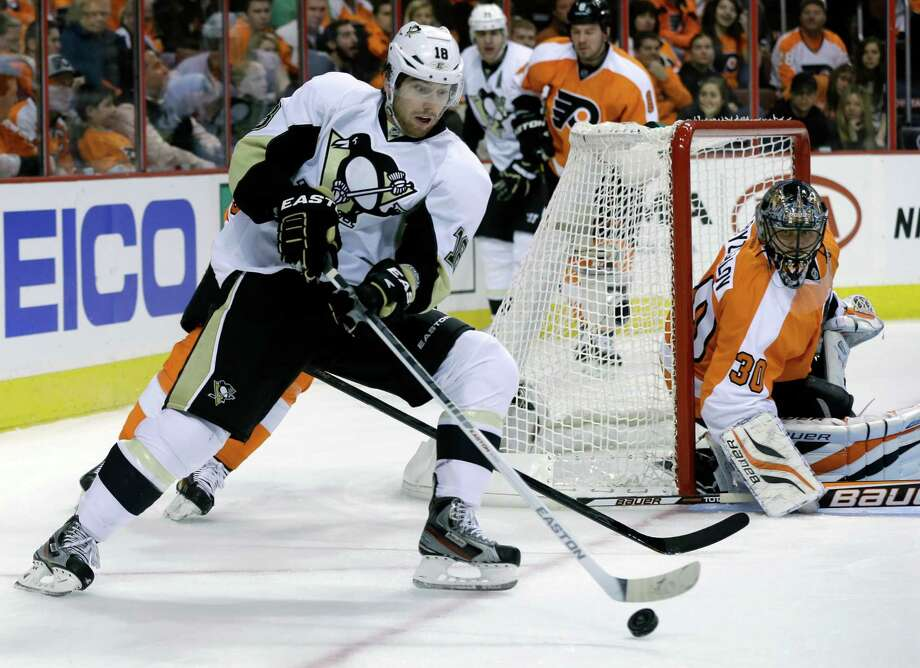 Philadelphia Flyers goalie Ilya Bryzgalov, of Russia (30) watches as Pittsburgh Penguins' James Neal (18) tries to control the puck during the first period of an NHL hockey game Saturday, Jan.19, 2013, in Philadelphia. (AP Photo/Mel Evans) Photo: Mel Evans