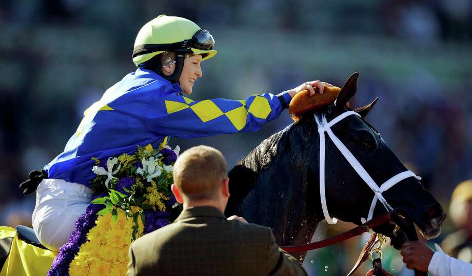 Jockey Rosie Napravnik sponges off Shanghai Bobby after winning the Breeders' Cup Juvenile horse race, Saturday, Nov. 3, 2012, at Santa Anita Park in Arcadia, Calif. (AP Photo/Mark J. Terrill) Photo: Mark J. Terrill / AP