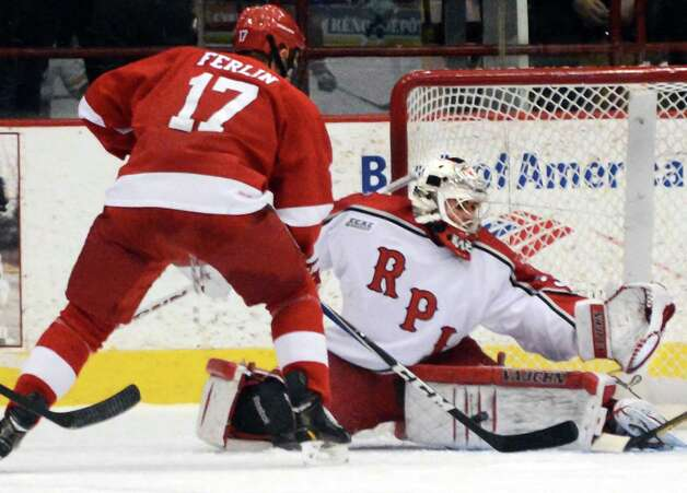 RPI goalie #33 Jason Kasdorf stops a shot from Cornell's #17 Brian Ferlin at the Houston Field House in Troy Saturday Jan. 19, 2013.  (John Carl D'Annibale / Times Union) Photo: John Carl D'Annibale / 00020777A