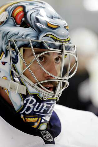 Buffalo Sabres goalie Ryan Miller looks on during an informal NHL hockey workout in Amherst, N.Y., Friday, Jan. 11, 2013. (AP Photo/David Duprey) Photo: David Duprey