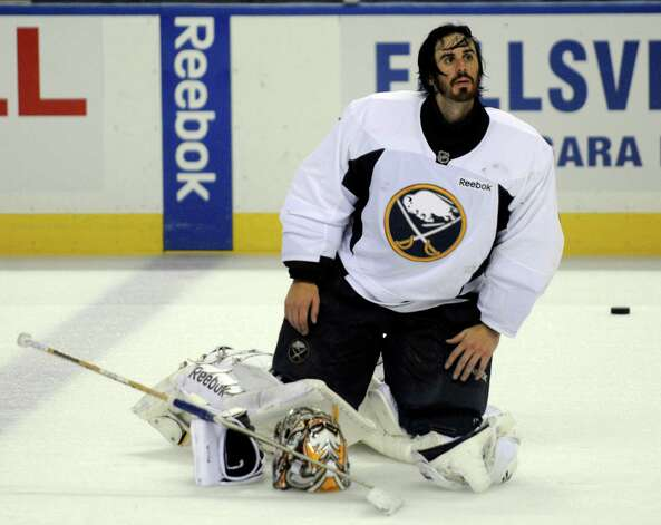 Buffalo Sabres' goalie Ryan Miller looks up after the first day of the NHL hockey training camp practice in Buffalo, New York on Sunday, Jan. 13, 2013. (AP Photo/Gary Wiepert) Photo: Gary Wiepert