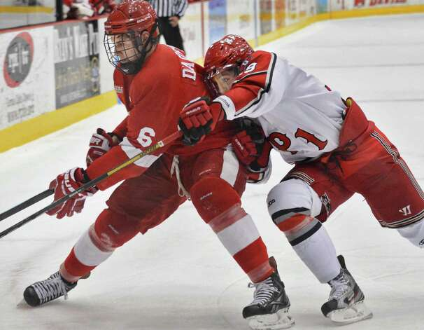 RPI's #39 Ryan Haggerty pressures Cornell's #6Nick D'Aagostino, at left, during Saturday's game at the Houston Field House in Troy Jan. 19, 2013.  (John Carl D'Annibale / Times Union) Photo: John Carl D'Annibale / 00020777A