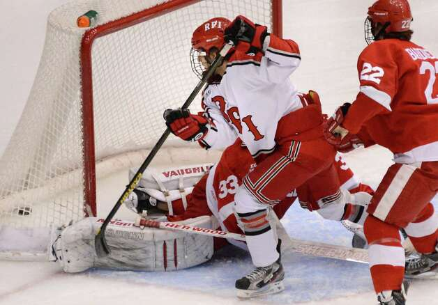 RPI's #29 Nick Bailen, center, scores against Cornell goalie Andy Iles at the Houston Field House in Troy Saturday Jan. 19, 2013.  (John Carl D'Annibale / Times Union) Photo: John Carl D'Annibale / 00020777A