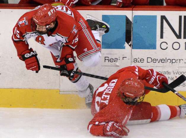 RPI's. #15 Jacob Laliberte, left, and Cornell's John Knisley collide during Saturday's game at the Houston Field House in Troy Jan. 19, 2013.  (John Carl D'Annibale / Times Union) Photo: John Carl D'Annibale / 00020777A