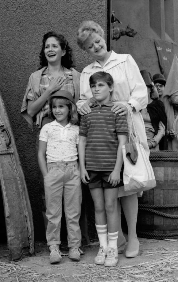 Joaquin Phoenix (front, right) followed his siblings into acting and started as a child. He's pictured in an 1984 episode of 'Murder, She Wrote' with Angela Lansbury (back, right) and his sister Summer Phoenix (front, left). Photo: CBS Photo Archive, Getty Images / 2005 CBS WORLDWIDE INC.