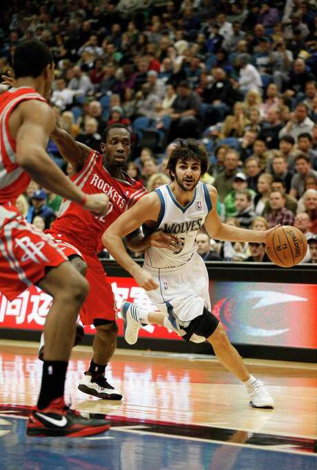 Timberwolves guard Ricky Rubio (9) eludes Rockets guard Patrick Beverley (12) on his way to seven points and six assists Saturday night. Photo: Stacy Bengs, FRE / FR170489 AP