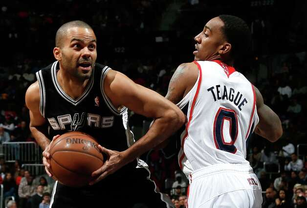 Tony Parker (9) of the Spurs drives past Jeff Teague (0) of the Hawks at Philips Arena on Jan. 19, 2013 in Atlanta. Photo: Kevin C. Cox, Getty Images / 2013 Getty Images