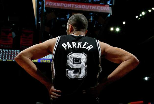 Tony Parker (9) of the Spurs waits to inbound the ball against the Hawks at Philips Arena on Jan. 19, 2013 in Atlanta. Photo: Kevin C. Cox, Getty Images / 2013 Getty Images