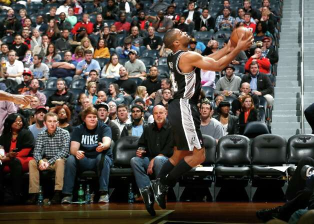 Gary Neal (14) of the Spurs saves a ball from going out of bounds against the Hawks at Philips Arena on Jan. 19, 2013 in Atlanta. Photo: Kevin C. Cox, Getty Images / 2013 Getty Images