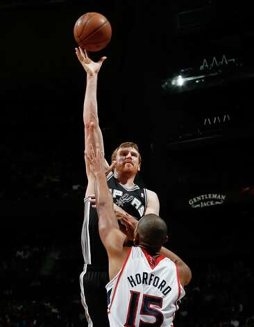 Matt Bonner (15) of the Spurs shoots over Al Horford (15) of the Hawks at Philips Arena on Jan. 19, 2013 in Atlanta. Photo: Kevin C. Cox, Getty Images / 2013 Getty Images