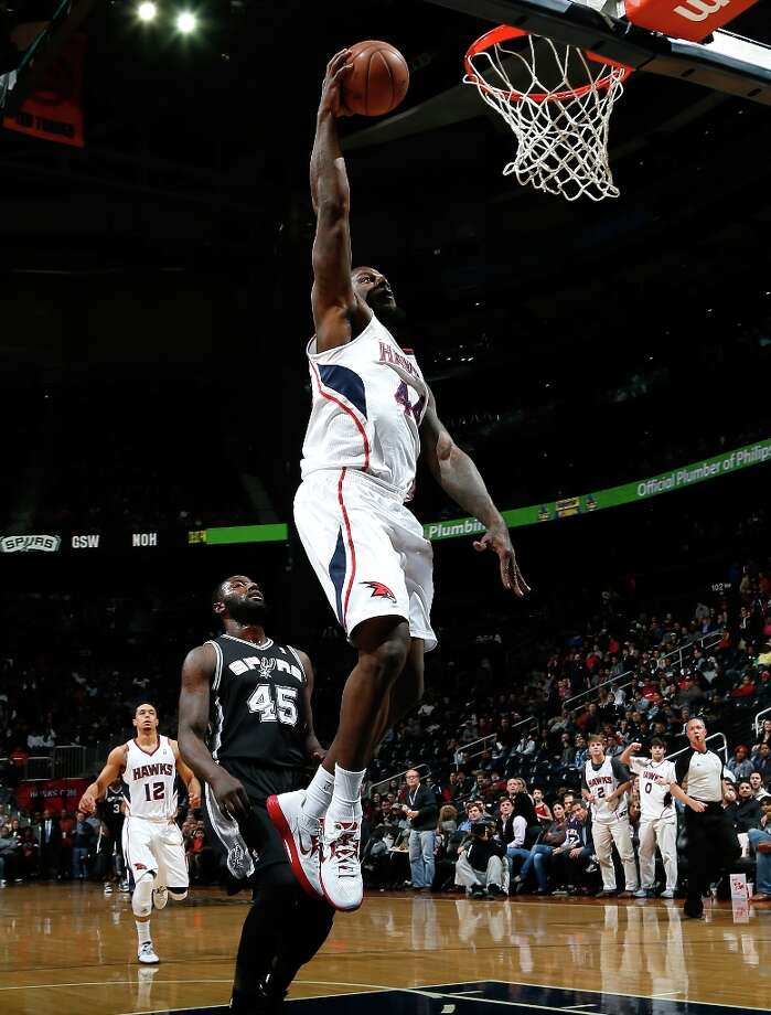 Ivan Johnson (44) of the Hawks dunks after stealing the ball from DeJuan Blair of the Spurs at Philips Arena on Jan. 19, 2013 in Atlanta. Photo: Kevin C. Cox, Getty Images / 2013 Getty Images