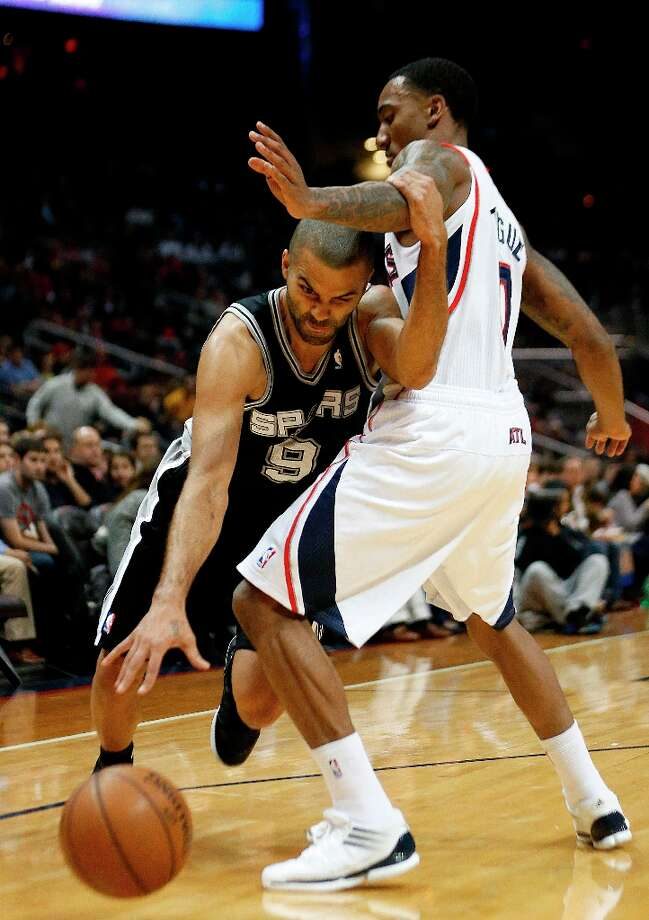 Spurs guard Tony Parker (9) drives against Hawks guard Jeff Teague (0) in the first half  Saturday, Jan. 19, 2013, in Atlanta. Photo: John Bazemore, Associated Press / AP