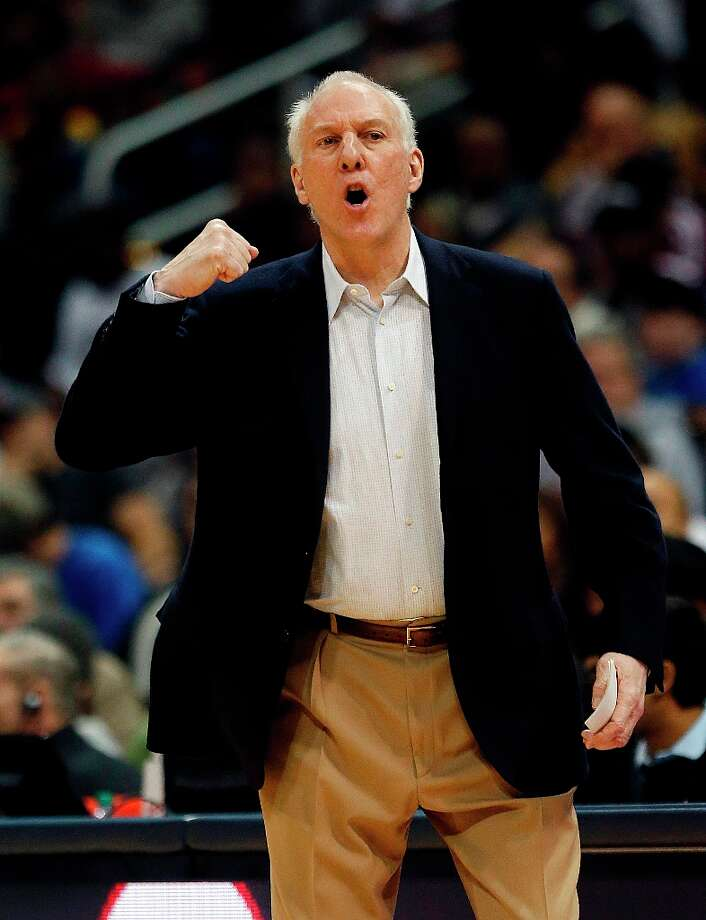 Spurs coach Gregg Popovich directs his team from the sideline in the second  half against the Hawks Saturday, Jan. 19, 2013, in Atlanta.  San Antonio won 98-93. Photo: John Bazemore, Associated Press / AP