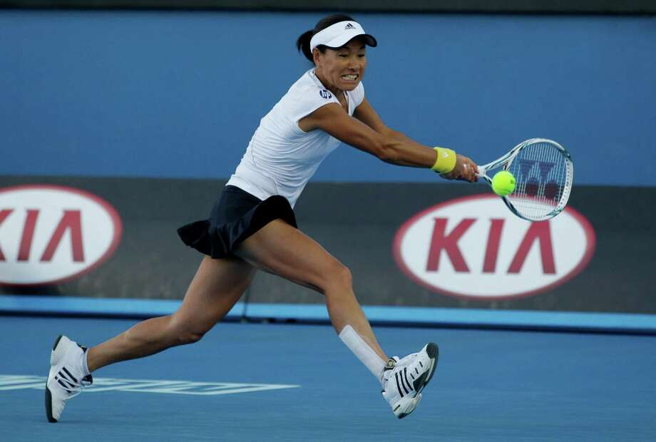 Japan's Kimiko Date-Krumm makes a backhand return to Serbia's Bojana Jovanvski during their third round match at the Australian Open tennis championship in Melbourne, Australia, Saturday, Jan. 19, 2013. (AP Photo/Aaron Favila) Photo: Aaron Favila