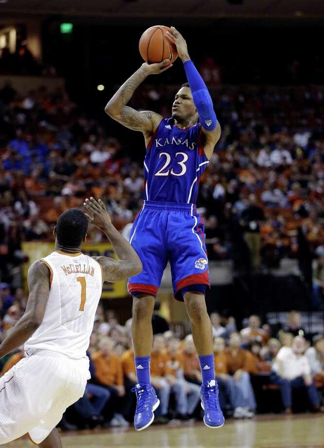 Kansas' Ben McLemore (23) shoots over Texas' Sheldon McClellan (1) during the second half of an NCAA college basketball game, Saturday, Jan. 19, 2013, in Austin, Texas. Kansas won 64-59. (AP Photo/Eric Gay) Photo: Eric Gay