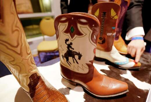 Cowboy boots are displayed during the Texas State Society's Black Tie & Boots Inaugural Ball, part of the 57th Presidential Inauguration, Saturday, Jan. 19, 2013, in National Harbor, Md. Photo: Charlie Neibergall, Associated Press / AP