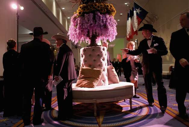 Revelers arrive to the Texas Black Tie and Boots inaugural ball on January 19, 2013 in National Harbor, Maryland. Thousands of Texans turned out to celebrate the upcoming second inauguration of U.S. President Barack Obama. Photo: John Moore, Getty Images / 2013 Getty Images