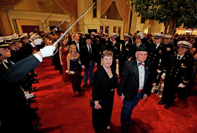 VIP's walk the red carpet under the salute of the Naval Academy cadets during the Black Tie and Boots ball as part of the Inaugural festivities Saturday, Jan. 19, 2013 in National Harbor, Md. Photo: Steve Helber, Associated Press / AP