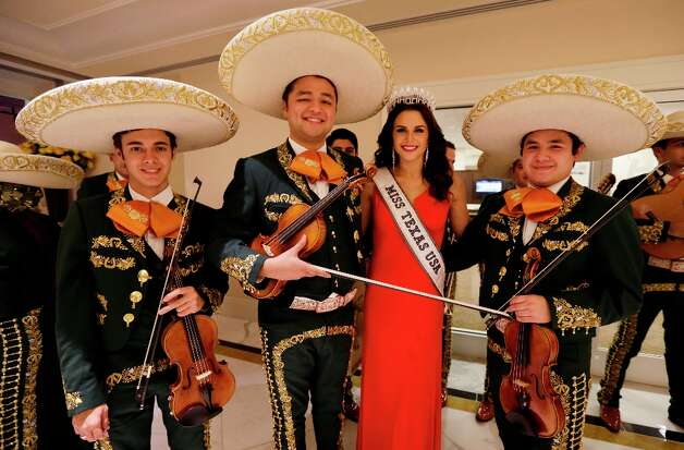 Miss Texas USA Ali Nugent poses with the University of Texas-Pan American mariachi band during the Texas State Society's Black Tie & Boots Inaugural Ball, part of the 57th Presidential Inauguration, Saturday, Jan. 19, 2013, in National Harbor, Md. Photo: Charlie Neibergall, Associated Press / AP