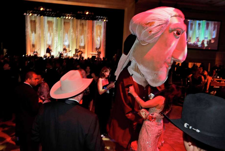 A Thomas Jefferson character dances with a cowgirl during the Black Tie & Boots ball as part of the Inaugural festivities Saturday, Jan. 19, 2013 in National Harbor, Md. Photo: Steve Helber, Associated Press / AP