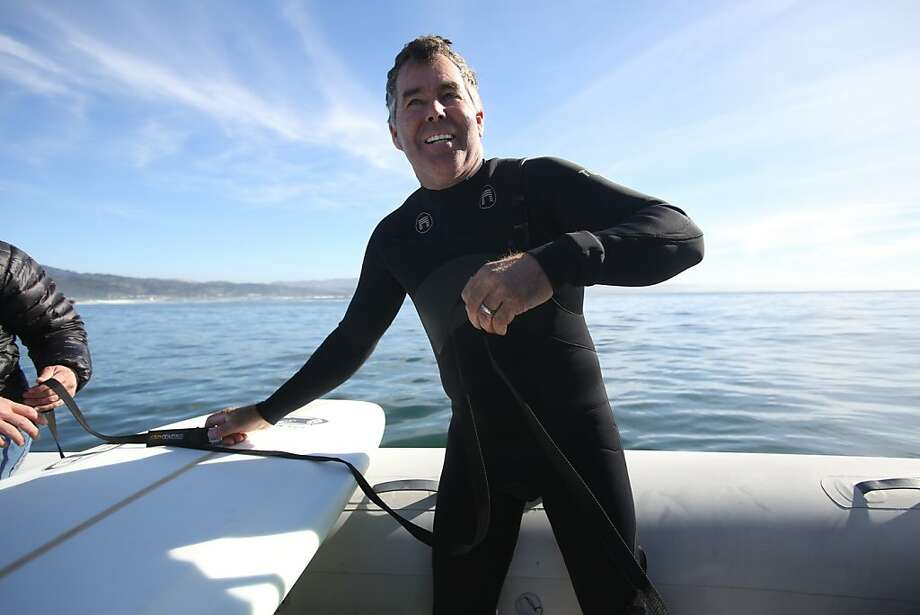 On the day before the Mavericks Invitational, Mavericks pioneer Jeff Clark gets ready to catch a few waves at the big wave spot on Saturday, January 19, 2013. Photo: Mathew Sumner, Special To The Chronicle