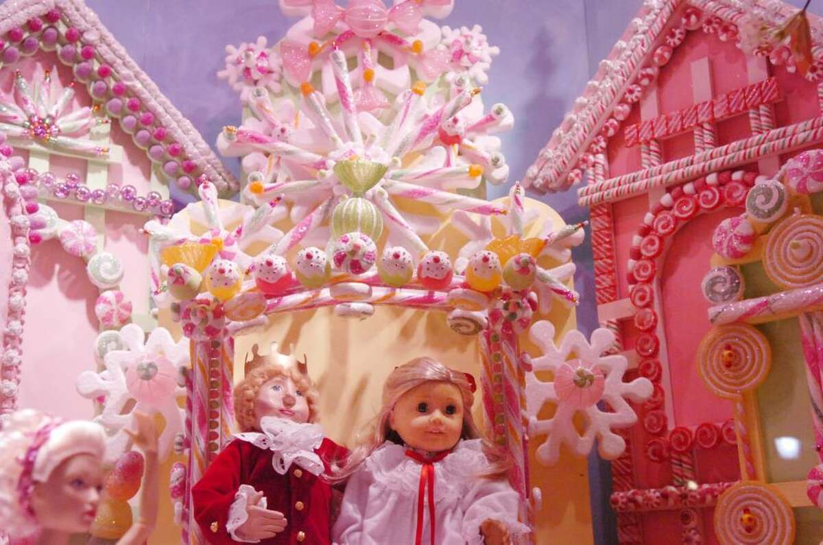 """The Nutcracker Prince escorts Clara Silberhaus through the """"Land of the Sweets"""" in a scene from the Nutcracker which plays out in Hoagland's 2009 holiday window display."""
