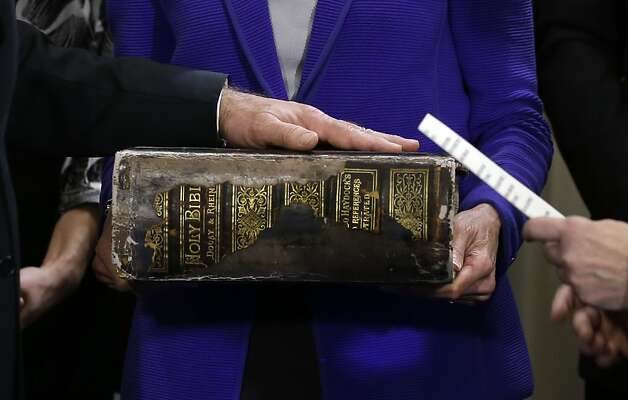 U.S. Vice President Joe Biden (L) places his hand on the Biden family Bible held by his wife Jill Biden as he takes the oath of office from Supreme Court Justice Sonia Sotomayo during and official ceremony at the Naval Observatory on January 20, 2013 in Washington. Photo: Carolyn Kaster, AFP/Getty Images