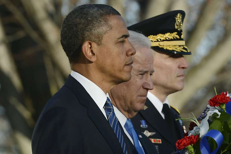 ARLINGTON, VA - JANUARY 20:  U.S. President Barack Obama, U.S. Vice President Joe Biden and Major General Michael S. Linnington, Commander of the US Army Military District of Washington participate in a wreath-laying ceremony at the Tomb of the Unknown Soldier January 20, 2013 in Arlington National Cemetery, Arlington, Virginia. Both Obama and Biden will be sworn in today for a second term in office. (Photo by Michael Reynolds-Pool/Getty Images) Photo: Pool, Getty Images