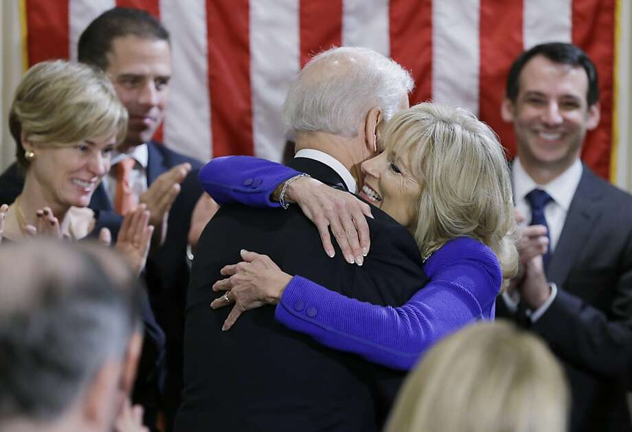 WASHINGTON - JANUARY 20:  U.S. Vice President Joe Biden (C) hugs his wife Dr. Jill Biden (2dn R) after taking the oath of office on during the official swearing-in ceremony at the Naval Observatory on January 20, 2013 in Washington, DC. Biden and U.S. President Barack Obama will be officially sworn in a day before the ceremonial inaugural swearing-in. Photo: Pool, Getty Images